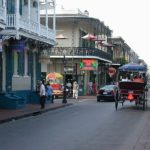 Bourbon Street with buildings on side and horse & buggy