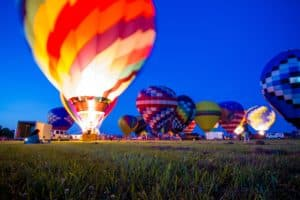 Hot air balloon tethered and lit up