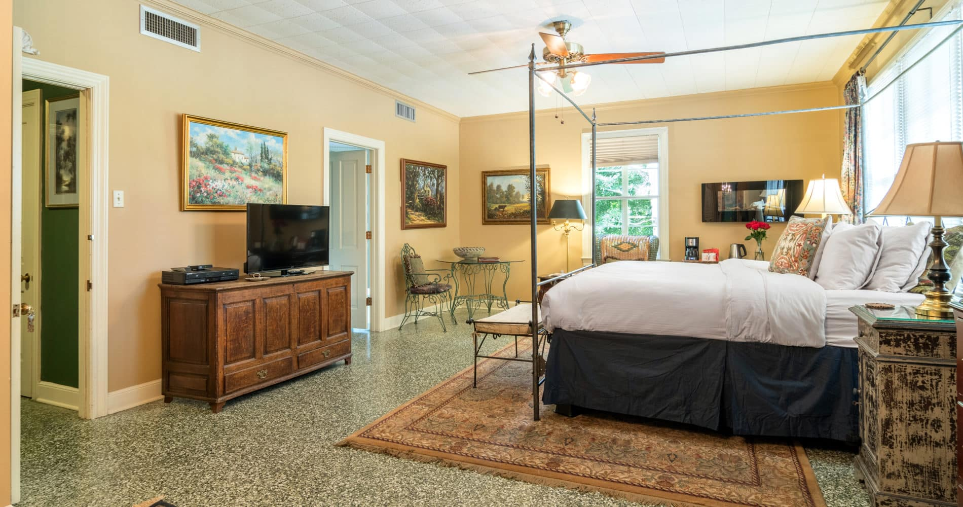 Escape room with 4-poster bed, furniture, paintings on walls