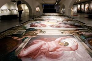 Example exhibit of ceiling of Sistine Chapel on floor