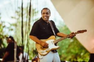Blues artist holding guitar