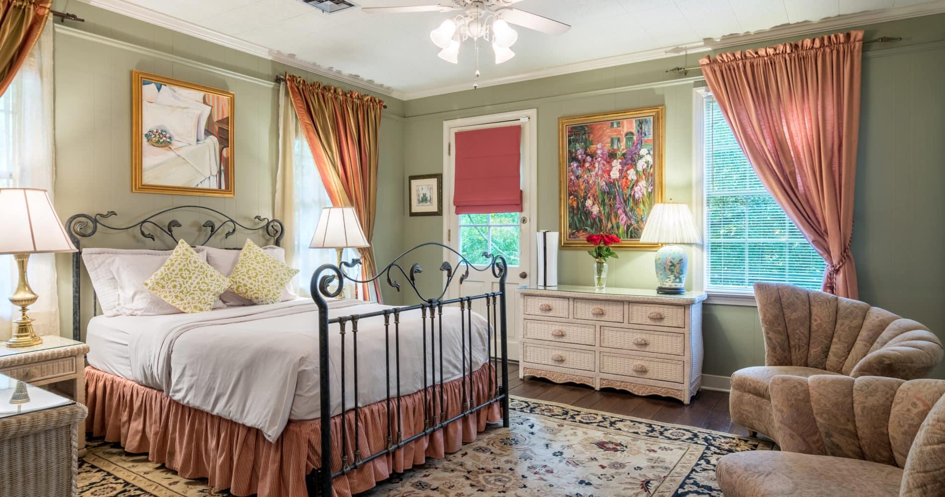 Garden Room with wrought iron queen bed, dresser, sitting area