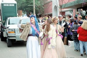 Two ladies dressed in costume walking in the Spanish Town Mardi Gras Parade