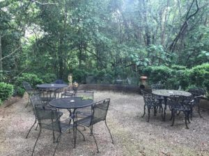 Back patio at The Stockade with wrought-iron tables and chairs
