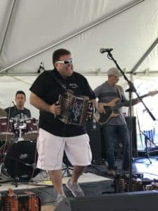 Zydeco musician playing black accordian
