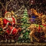 Santa and sleigh with tree in snow