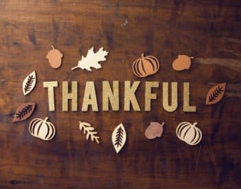 Board with the word Thankful on it and things related to Fall