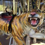 Gold tiger ride on a carousel.