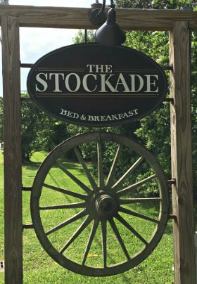 Sign with The Stockade at the top and wagon wheel at the bottom, signifying Baton Rouge as a hub and spoke city