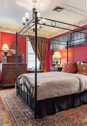 Red Room with Queen-size wrought iron bed and red walls