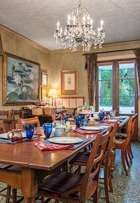 Breakfast Room with chandelier and painting on wall of lilies